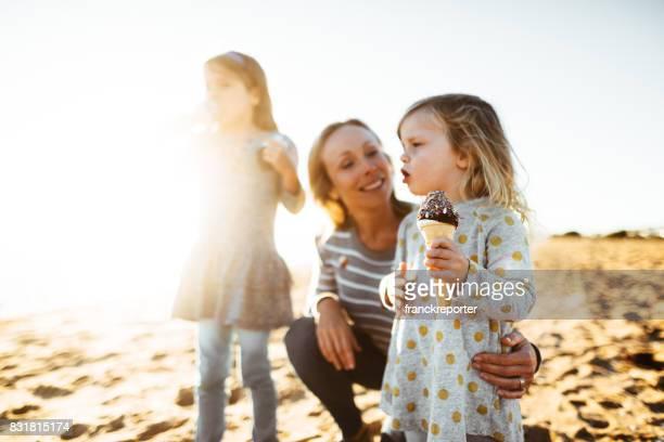happy family eating the icecream on the beach