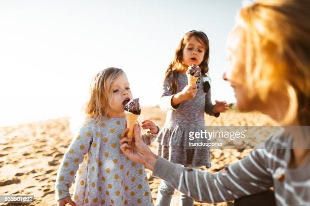 happy family eating the icecream on the beach