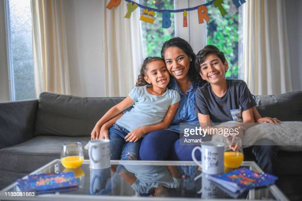 happy family enjoying birthday party at home - happy birthday images for sister stock pictures, royalty-free photos & images