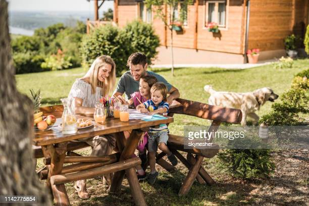 happy family enjoying in coloring at the backyard. - coloring stock pictures, royalty-free photos & images