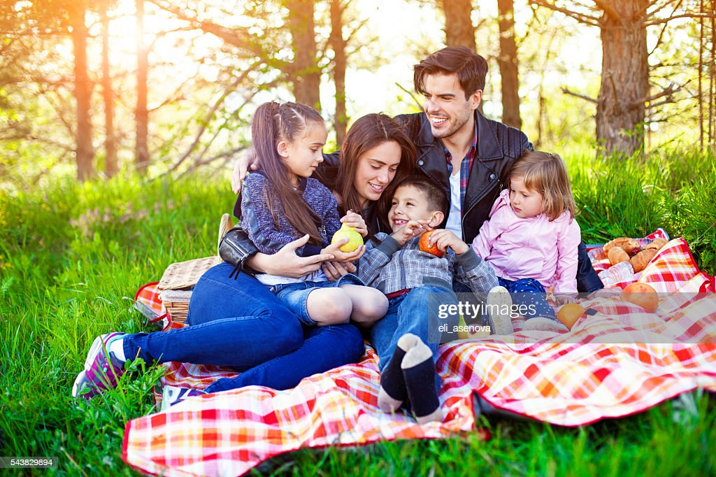 Happy family enjoying in picnic day in the forest. : Stock Photo