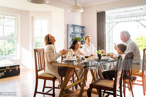happy family enjoying lunch at home - dining room stock pictures, royalty-free photos & images