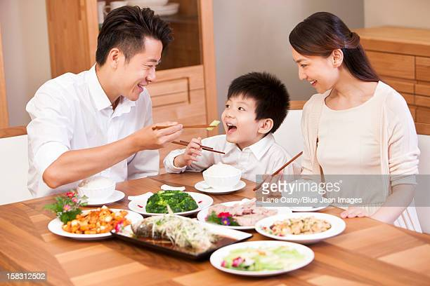 Happy family enjoying meal time