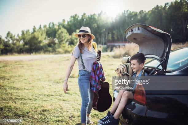 happy family  enjoying picnic and camping holiday in countryside - wilderness stock pictures, royalty-free photos & images