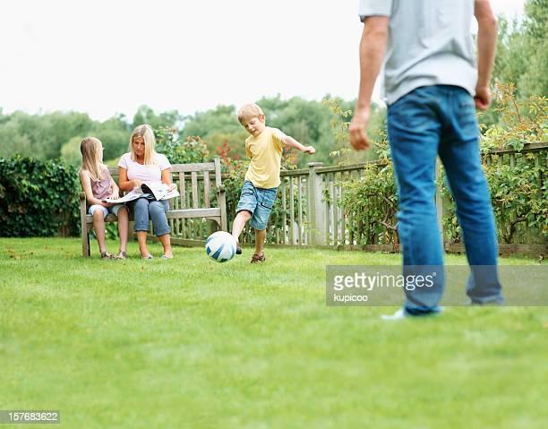 Happy family enjoying vacation together at park