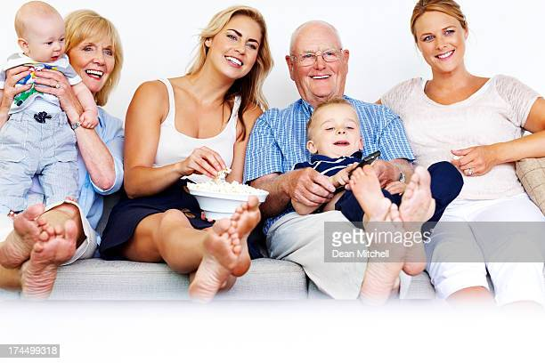Happy family enjoying watching television