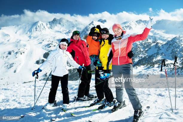 happy family enjoying winter vacations in mountains - andorra stock pictures, royalty-free photos & images