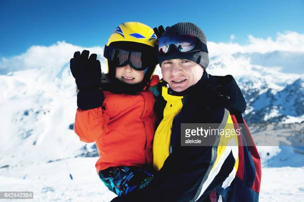 Happy family enjoying winter vacations in mountains