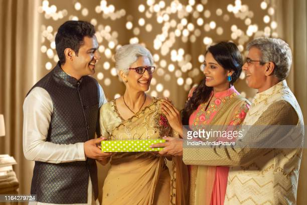happy family exchanging gifts on the occasion of diwali festival - exchanging stock pictures, royalty-free photos & images