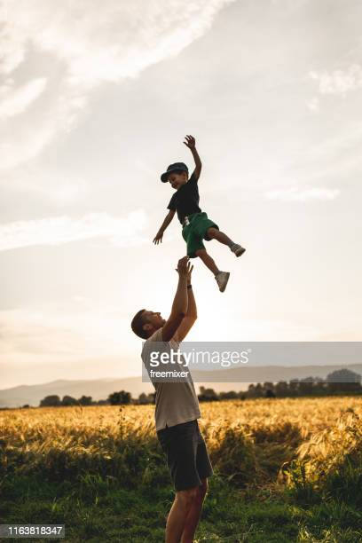happy family, father playing with son - throwing stock pictures, royalty-free photos & images