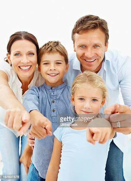 Happy family gesturing over plain background