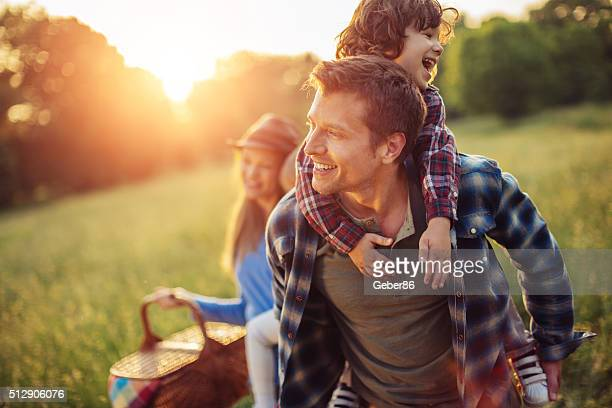 happy family going for picnic - public park stock photos and pictures
