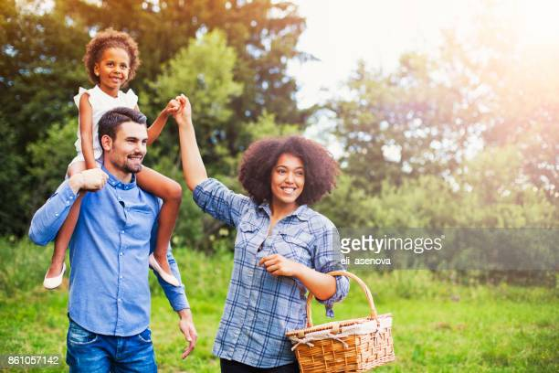 happy family going for picnic - mixed race person stock pictures, royalty-free photos & images