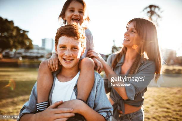 happy family have fun in the park - australia photos stock photos and pictures