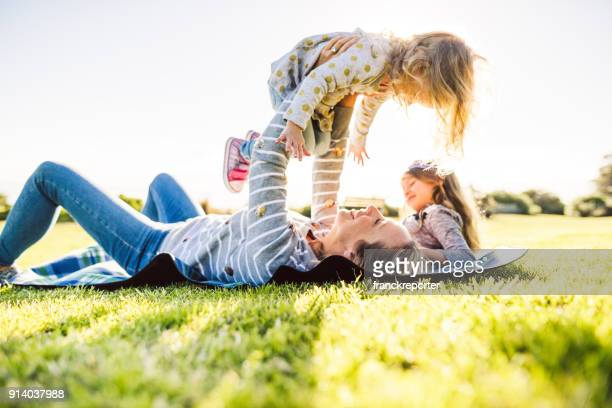 happy family have fun in the park - picnic stock pictures, royalty-free photos & images
