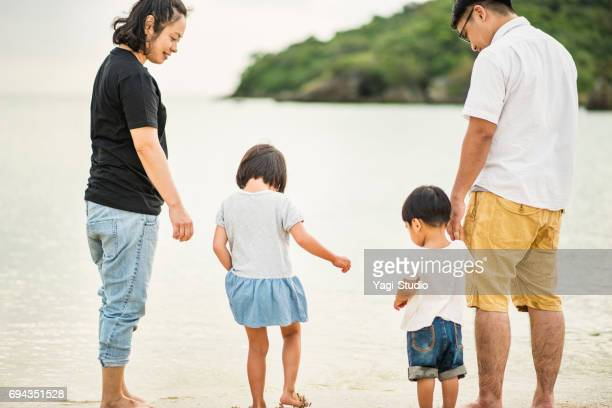 Happy family having a good time in beach.