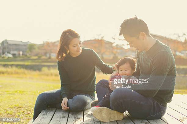 happy family having a good time with baby girl - three people ストックフォトと画像