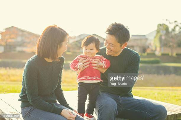 Happy family having a good time with baby girl