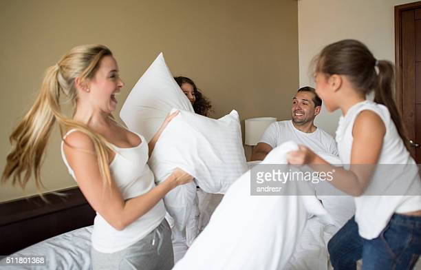 Happy family having a pillow fight