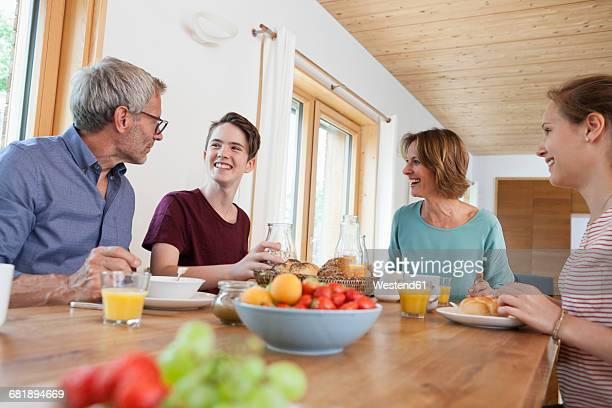 Happy family having breakfast at home