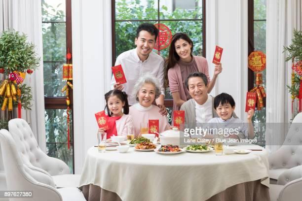 Happy family having Chinese New Year dinner