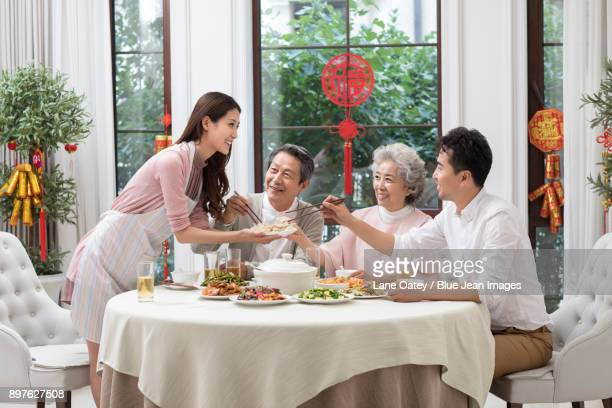 happy family having chinese new year dinner - 70 year old man stock pictures, royalty-free photos & images