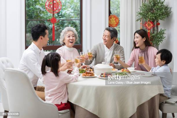 happy family having chinese new year dinner - wiedersehenstreffen stock-fotos und bilder