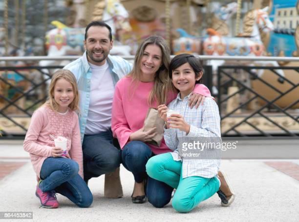 Happy family having fun at a carnival fair