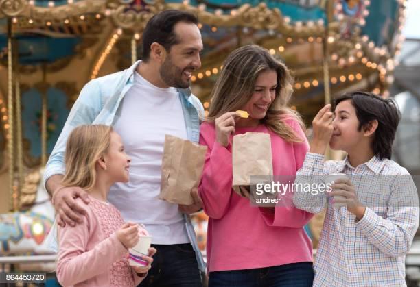Happy family having fun at an amusement park
