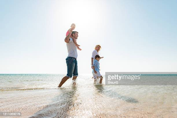 happy family having fun in summer day at sea. - north africa stock pictures, royalty-free photos & images