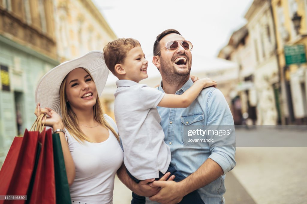 Happy family having fun outdoor after shopping : Stock Photo