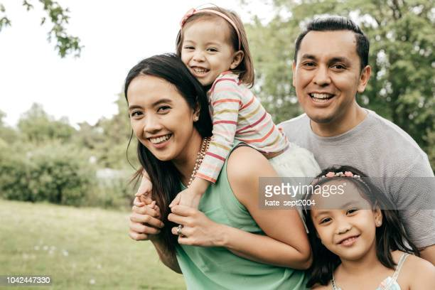 happy family having fun outdoor - spanish and portuguese ethnicity stock pictures, royalty-free photos & images