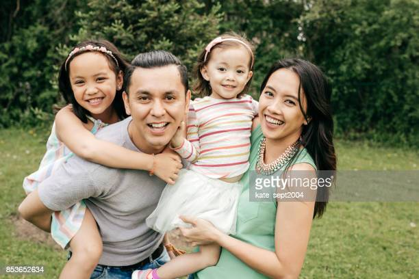 happy family having fun outdoor - family photos stock photos and pictures