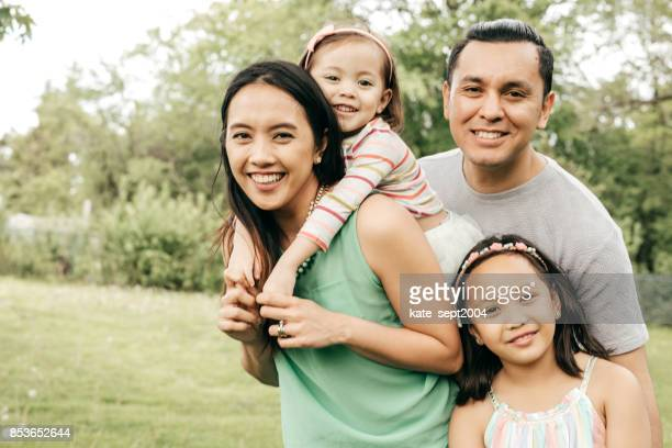 happy family having fun outdoor - filipino family stock pictures, royalty-free photos & images