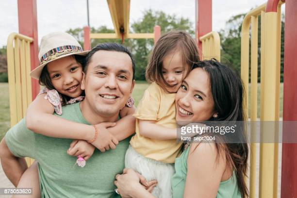 happy family having fun outdoor - iberian ethnicity stock pictures, royalty-free photos & images
