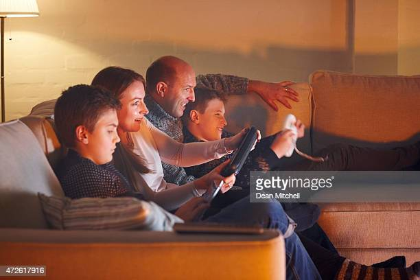 Happy family having fun playing video games