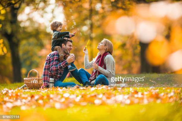 happy family having fun while spending an autumn day on picnic at the park. - in the park day 3 imagens e fotografias de stock