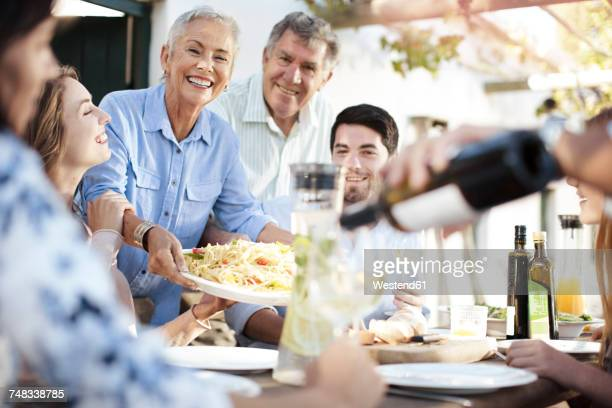 Happy family having lunch together outside