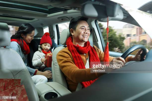 happy family home for the new year - family inside car stock photos and pictures
