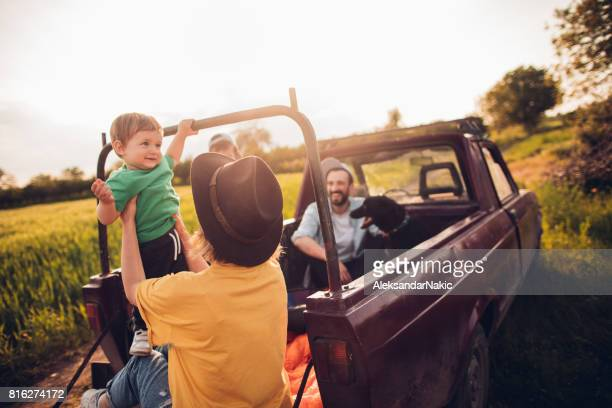 Happy family in a pick-up truck