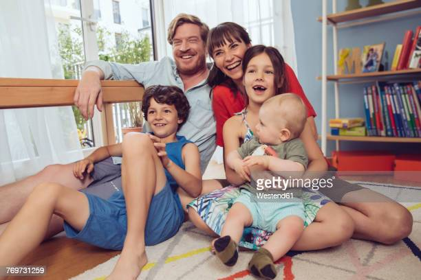 Happy family in childrens room
