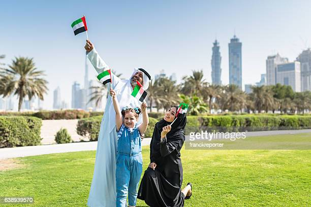 happy family in dubai for the national day - flag stock pictures, royalty-free photos & images