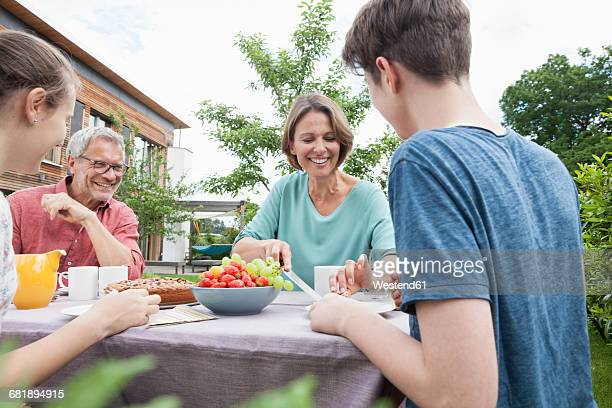 Happy family in garden having afternoon break