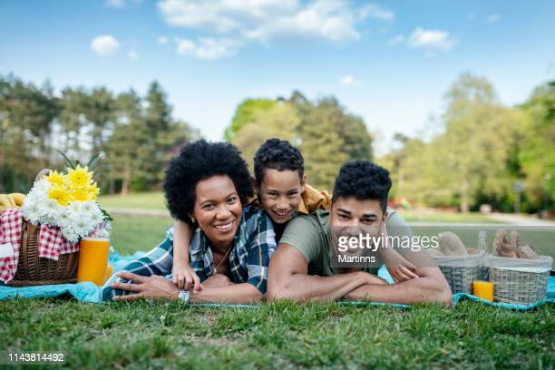 happy family in nature smiling for the camera - picnic stock pictures, royalty-free photos & images