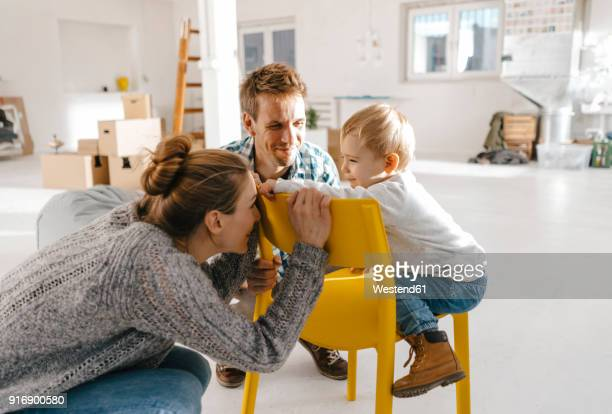 happy family in new home - family with one child stock pictures, royalty-free photos & images