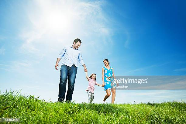 happy family in park taking a walk - low angle view stock pictures, royalty-free photos & images