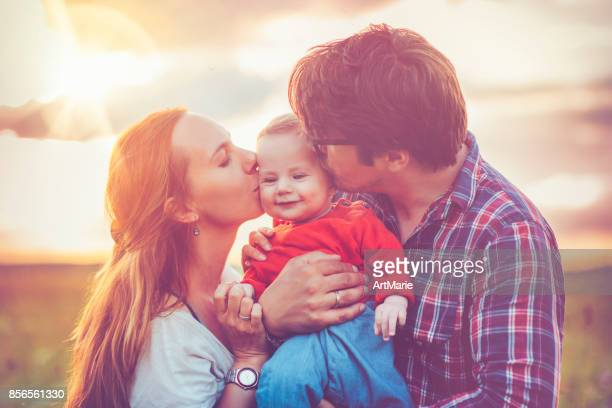 Happy family in sunset