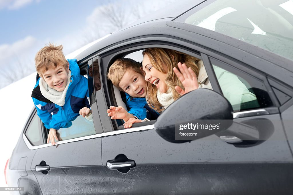 Happy family in the car on winter day : Stock Photo