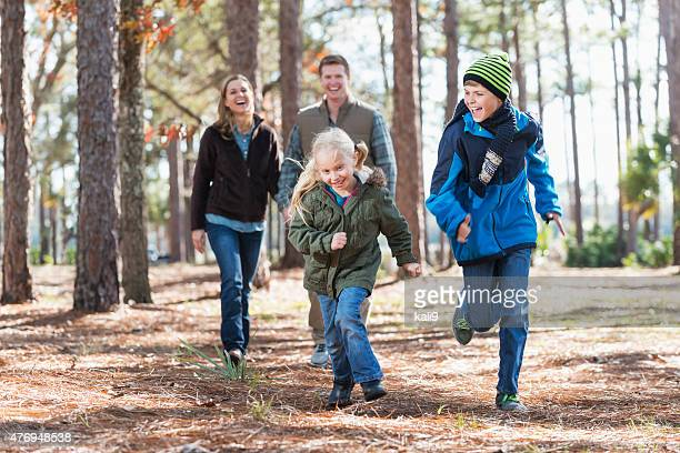 Happy family in the park, children running