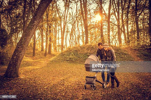 Happy family in the park on autumn day